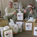 Greg Naftzger and Paul Clark pose with the donations of soup from Santa!